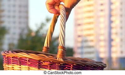 A multicolored wicker basket turns around in summer