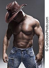 A muscular man in a cowboy hat