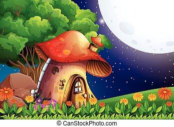 A mushroom house under the bright fullmoon
