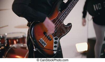 A musical band finished playing a song - a bassist on the ...