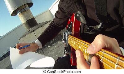A musician writes songs
