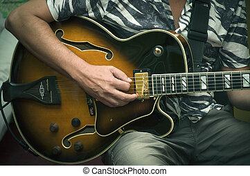 a, musiker, spiele, der, gitarre