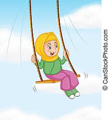 A muslim girl on swing