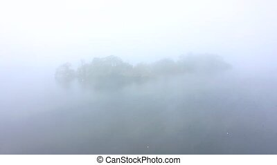 A mysterious small island appears out the fog - Hornsea Mere...