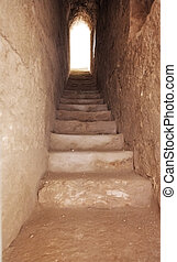 a narrow passage with a stone staircase