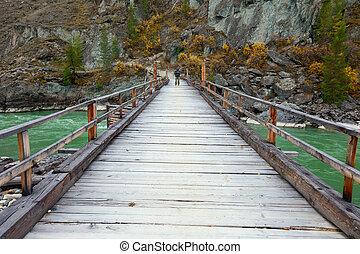 A narrow wooden bridge
