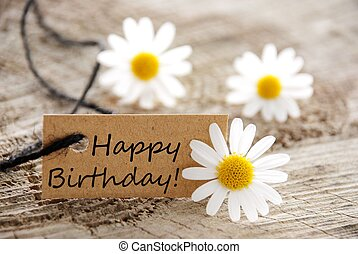 a natural looking banner with happy birthday and white blossoms as background