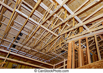 A new home under construction interior and plumbing inside a house frame.