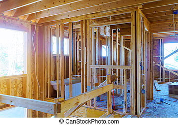 A new home under construction interior inside house frame.