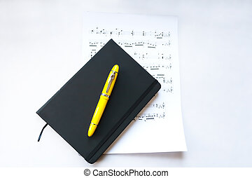 A new notebook and a yellow fountain pen to write down the ...