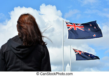 Anzac Day services - A New Zealander person (woman) under...