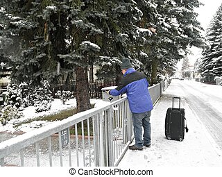 A newspaper deliverer in winter