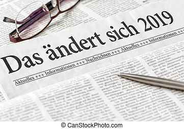 A newspaper with the german headline Das aendert sich 2019 - Changes coming in 2019