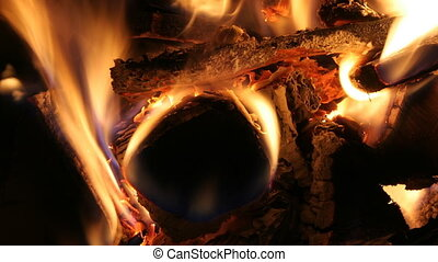 a nice log fire burning in a fireplace
