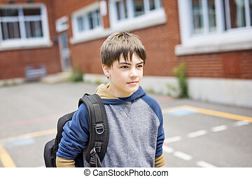 Nice Pre-teen boy outside at school having good time - A...