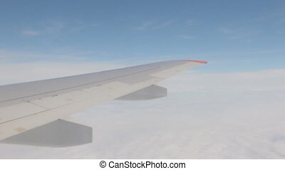 A nice view of the airplane wing from the airplane window.