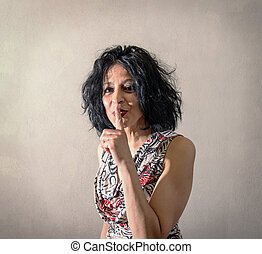 nice woman doing the gesture of silencing