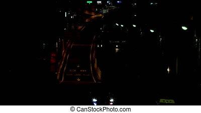 A night city street at the downtown in Setagaya Tokyo long shot