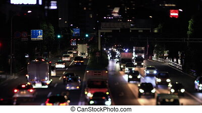 A night city street at the downtown in Setagaya Tokyo tilt shift