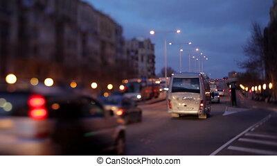 a night shot of a street scene in barcelona, spain using...