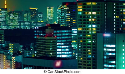 A night timelapse of cityscape at the urban city in Tokyo long shot panning