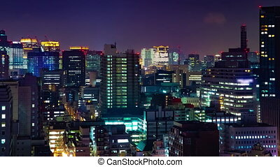 A night timelapse of cityscape at the urban city in Tokyo medium shot panning