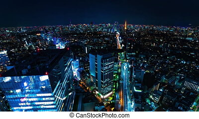 A night timelapse of cityscape at the urban city in Tokyo wide shot high angle panning