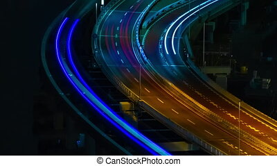 A night timelapse of cityscape of the bridge street in Tokyo long shot panning