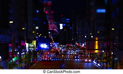 A night timelapse of the miniature urban city street near Tokyo tower in Tokyo
