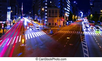 A night timelapse of the urban city street near Tokyo tower in Tokyo