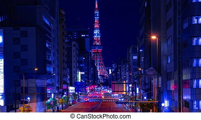 A night timelapse of the urban city street near Tokyo tower in Tokyo panning