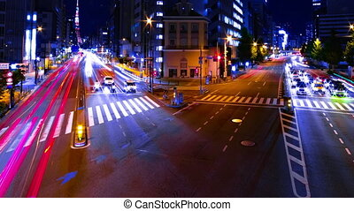 A night timelapse of the urban city street near Tokyo tower in Tokyo tilt