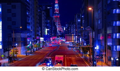 A night timelapse of the urban city street near Tokyo tower in Tokyo zoom