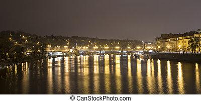 A night view of the river Vltava in Prague, Czech Republic