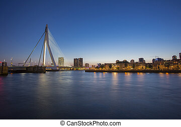 A night view on Erasmus bridge over the Nieuwe Maas river in Rotterdam, Netherlands