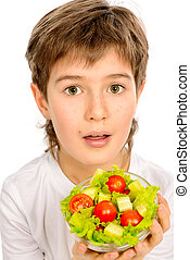 vegetable salad - A nine year old boy holding fresh...