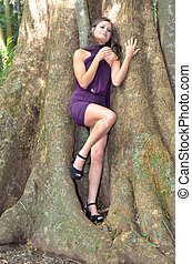 A nook in the tree - Lady standing in a nook in a tree
