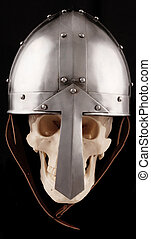 helmet - A Norman helmet with a silver human skull on a ...