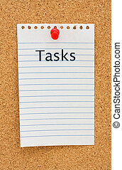 Listing your tasks - A note on white lined paper tacked to a...