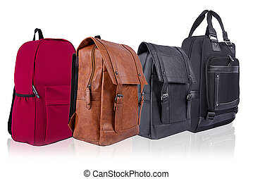 A number of backpacks of different colors on a white background isolated