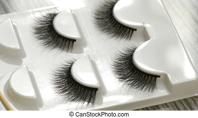 A number of unused false eyelashes in special box - A number...
