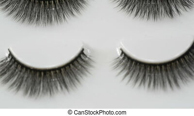 A number of unused false eyelashes in special box close up...