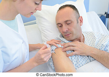 a nurse inoculating a middle-aged man