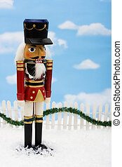 Nutcracker - A nutcracker with a white picket fence with...
