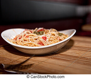 a of spaghetti on wooden table