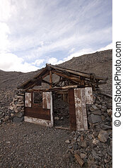 A old abandoned cabin in the desert. scenic house travel shack solitude