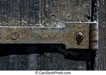old iron metal lock screw and wood