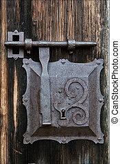 metal lock screw and wood