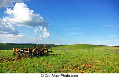 A old plough in field.
