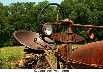 Old rusty farm tractor